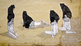 Abstract anonymous wall painting. Artistic painting of four women, each having a panther on their head Stock Photos