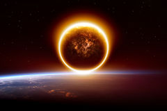 Abstract apocalyptic background. Sunset, impact of exploding planet, end of world. Elements of this image furnished by NASA Royalty Free Stock Images