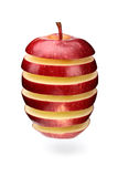 Abstract apple slices. A red apple sliced in layers and arranged with gaps Stock Photos