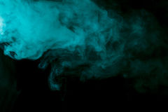Abstract aquamarine hookah smoke on a black background. Royalty Free Stock Photo