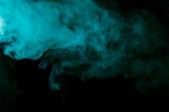 Abstract aquamarine hookah smoke on a black background. Royalty Free Stock Photo