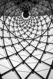 Abstract architectural background swirl steel beam glass roof. In black and white of Sathorn Square Building, Bang Rak, Bangkok, Thailand royalty free stock photo