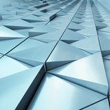 Abstract architectural detail. Abstract close-up view of modern aluminum ventilated triangles on facade Stock Photos