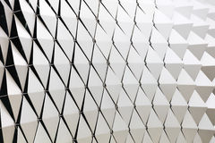 Abstract architectural pattern. Abstract close-up view of modern aluminum ventilated triangles on facade Royalty Free Stock Photo