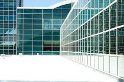 Abstract Architecture. Abstract of modern building architecture with reflective glass windows and sharp angles Royalty Free Stock Photos