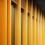 Abstract architecture fragment with metal facade and wind. Abstract architecture fragment with yellow metal facade and windows Royalty Free Stock Images