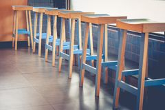 Abstract architecture row of empty vintage wooden chairs decorate in coffee cafe. Selective focus stock photography