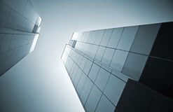 Abstract architecture with two tall walls opposite. Looking up in the city. Abstract architecture monochrome background with two tall concrete walls opposite stock photo