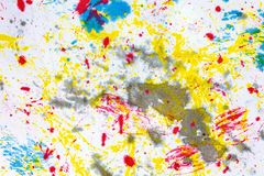 Abstract art background. Colored ink on paper. Blue and yellow light texture. Ink spots. Modern Art Stock Photo