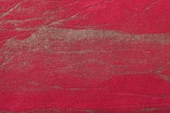 Abstract art background dark red with golden color. Multicolor painting on canvas. Fragment of artwork. Texture backdrop. stock photography