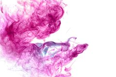 Abstract art colored blue and pink smoke on black isolated background. stock images