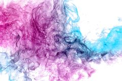 Abstract art colored blue and pink smoke on black isolated background. royalty free stock photos