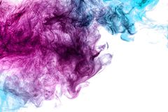 Abstract art colored blue and pink smoke on black isolated background. royalty free stock photography