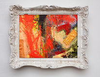 Abstract art expressionism canvas in vintage antique white frame. On the white wall. See more in my portfolio royalty free stock photo