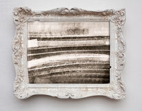 Abstract art expressionism canvas in vintage antique white frame. On the white wall. See more in my portfolio stock images