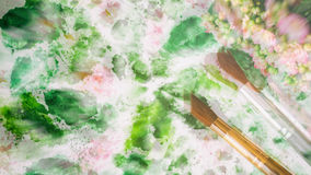 Abstract art hand watercolor and brushes, floral background. Blurred romantic concept of spring, lifestyle, hobbies. Top. Blurred romantic concept of spring Stock Image