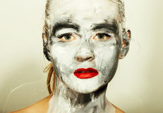 Abstract art makeup. Face and neck girls smeared with gray colors and bright red lips. Holi Festival.  stock photography