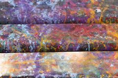 Abstract artistic background with splashes of paint. Abstract, hand painted colorful wooden background royalty free stock photography