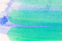 Abstract arts background. Macro shot of abstract hand drawn blue and green watercolor paints background Stock Photo
