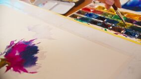 Abstract artwork female hand painting strokes