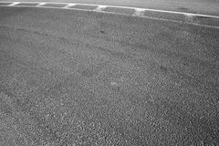 Abstract asphalt road fragment with marking lines Royalty Free Stock Photos