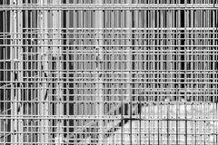 Abstract austere geometric pattern of iron bars, several barriers in front of a stadium. Black and white royalty free stock photo