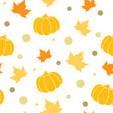 Abstract autumn background. Vector seamless pattern with orange pumpkin and maple leaves. Abstract autumn background Vector Illustration