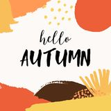 Abstract Autumn Design. With colorful brush strokes in yellow, red, brown and orange on white background. Text `Hello Autumn`. Modern and creative poster Stock Image