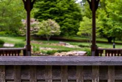 Abstract back rail of gazebo with blurry background. Royalty Free Stock Photos