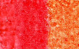 Abstract backdrop red orange smudges. Colorful painted background hand drawn with bright inks and watercolor paints. Bright color splashes and splatters create Stock Photography