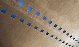 Abstract background. Detail of a roof with some windows seen as an abstract background Stock Images
