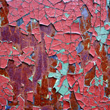 Abstract background. Rusty iron sheet with corrosion steins and the cracked paint Stock Photos
