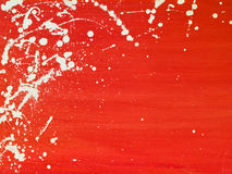 Abstract background. Red oilpainted background with white paint splashes Stock Photography