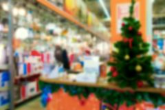 Abstract background. Abstract and de-emphasized background of the store on the eve of the New Year and a Christmas tree in the store Stock Images