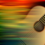 Abstract background with acoustic guitar. Abstract brown motion blur background with acoustic guitar Royalty Free Stock Image