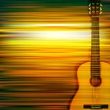 Abstract background with acoustic guitar. Abstract green blur music background with acoustic guitar Royalty Free Stock Image