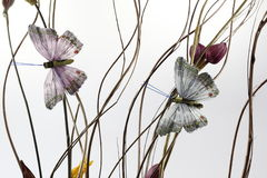Abstract background with artificial buterfly and flowers. On white background Stock Images