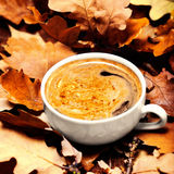 Abstract background with  autumn leaves and hot coffee cup. Ye Stock Image