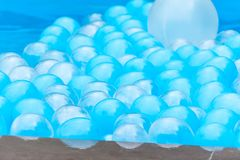 Abstract background with balloons in a pool stock images