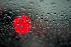 Abstract background for the banner. One night lights of city transport were seen through the windshield in rainy weather Stock Image
