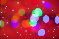 Abstract background. Beautiful red, green and blue circles on a red background Royalty Free Stock Photo