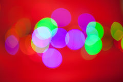 Abstract background. Beautiful red, green and blue circles on a red background Royalty Free Stock Images