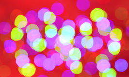 Abstract background. Beautiful red, green and blue circles on a red background Stock Images