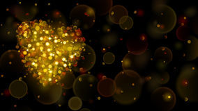 Abstract background with big gold heart with bokeh effect. Heart of blurred defocused lights in gold colors. Gold heart of bokeh lights with sparkles Royalty Free Stock Image