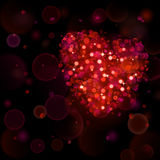 Abstract background with big red heart with bokeh effect. Heart of blurred defocused lights in red colors. Red heart of bokeh lights with sparkles Stock Photos