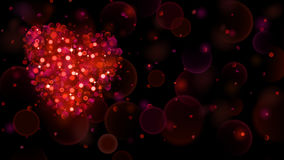 Abstract background with big red heart with bokeh effect. Heart of blurred defocused lights in red colors. Red heart of bokeh lights with sparkles Stock Photography