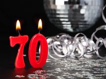 Red candles showing Nr. 70. Abstract Background for birthday or anniversary party Royalty Free Stock Photo