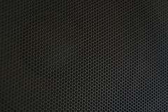 Abstract background is a black metal grid for the speaker close-up. Details audi Stock Photo