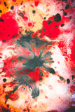 Abstract background with blots and spreads droplets of different colors. On paper close-up, filter stock photo