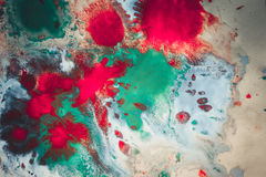 Abstract background with blots and spreads droplets of different colors. On paper close-up, filter stock photos